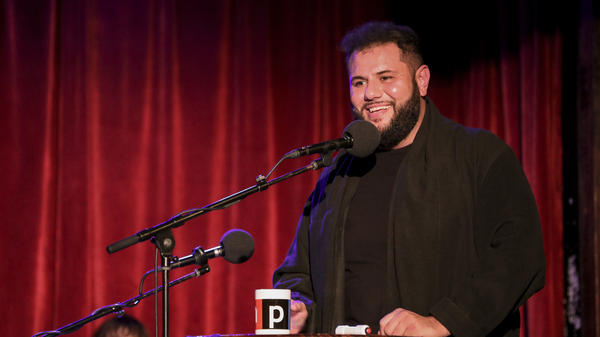 Comedian Mo Amer appears on <em>Ask Me Another</em> at the Bell House in Brooklyn, New York