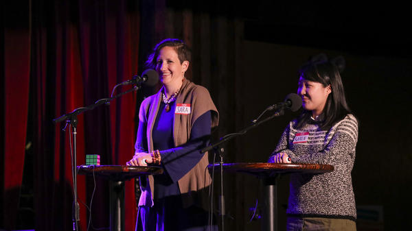 Contestants compete in the final round on <em>Ask Me Another</em> at the Bell House in Brooklyn, New York.