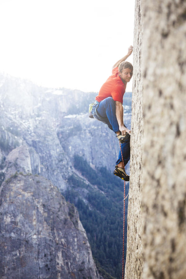 "Tommy Caldwell uses ""tiny razorblade edges"" in the rock wall to support his body weight on El Capitan's Dawn Wall."