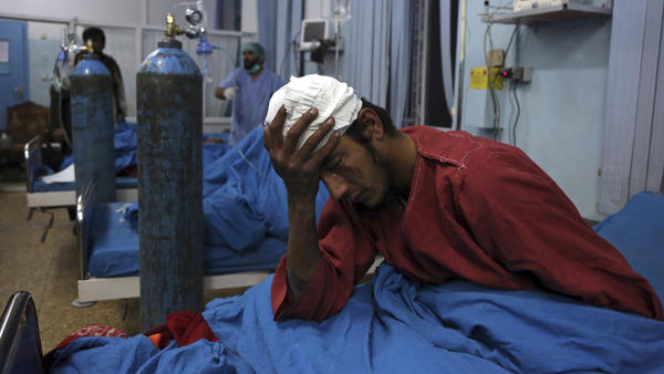 An injured man receives treatment at a hospital following a suicide bombing in Kabul, Afghanistan, on Tuesday.