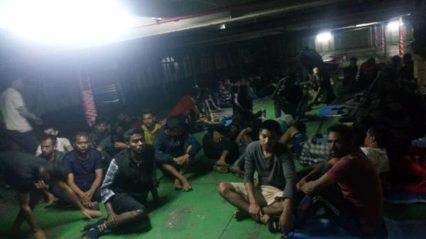 A photo provided Nov. 14 shows migrants on board the container ship Nivin, which rescued more than 90 migrants from a raft in the Mediterranean more than a week ago. Many of those migrants refused to disembark in Libya; they were forcibly removed from the ship on Tuesday.