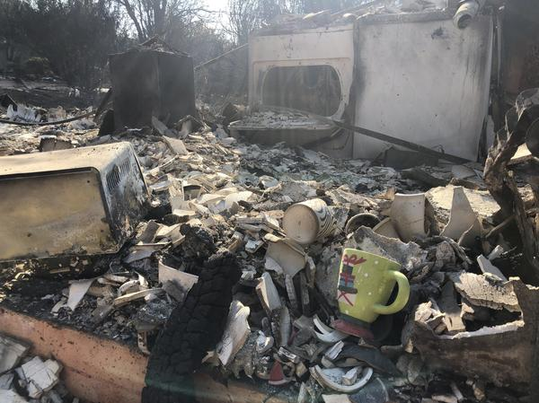 A holiday mug is seen among the wreckage of what was once someone's kitchen in Paradise, California.
