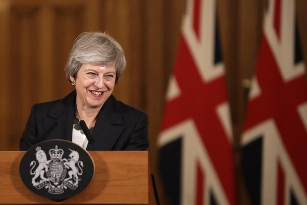 """Britain's Prime Minister Theresa May smiles during a press conference inside 10 Downing Street in London, Thursday, Nov. 15, 2018. British Prime Minister Theresa May says if politicians reject her Brexit deal, it will set the country on """"a path of deep and grave uncertainty."""" Defiant in the face of mounting criticism, May said Thursday she believed """"with every fiber of my being"""" that the deal her government struck with the European Union was the right one. (Matt Dunham, Pool/AP)"""