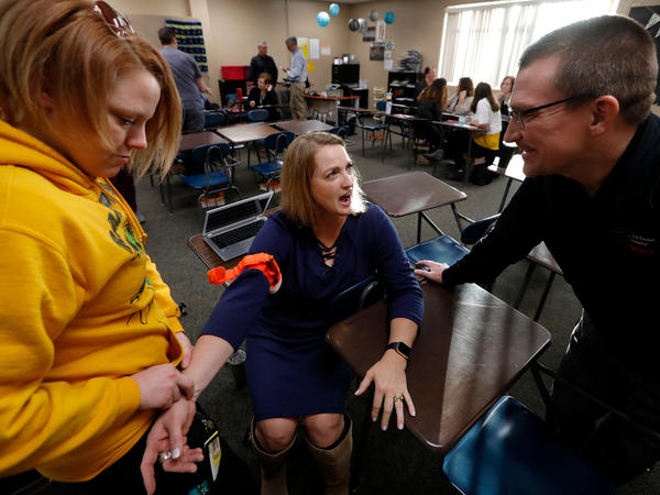 In Parkland, Florida, site of a mass shooting this year, a commission is recommending that so-called 'stop the bleed' kits be put in every classroom.  It comes amid a national push for medical training of educators, like those pictured at Southeast Polk High School in Pleasant Hill, Iowa.