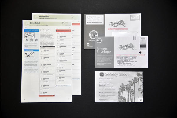 Demo 2018 voting materials from the Los Angeles County Board of Elections feature lower case letters, left-aligned text, a clean sans-serif font, simple instructions and color coding.