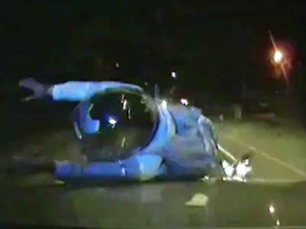 A screenshot of footage showing London police cars colliding with people riding mopeds.