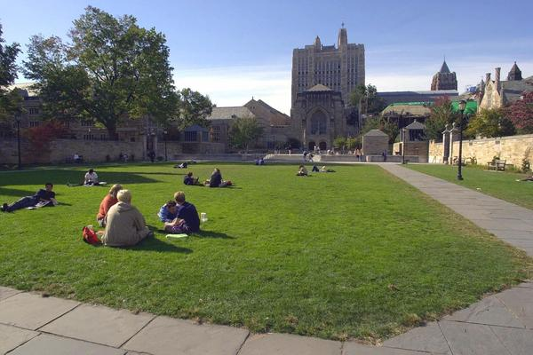 Yale University students and others spend a fall afternoon on Yale University's Cross Campus in New Haven, Conn., in an Oct. 11, 2000 file photo. (AP Photo/Bob Child/file)