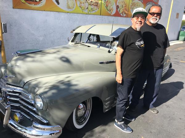 Thee Midniters' Little Willie G (left) and his friend Larry Saez show off the latter's car, a tricked-out 1948 Chevrolet Fleetline.