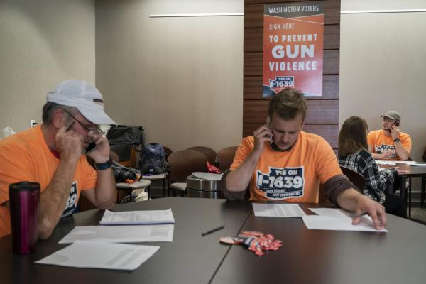 Volunteers with the Yes on I-1639 campaign call voters in Washington state on September 15, 2018, in Vancouver, Washington.