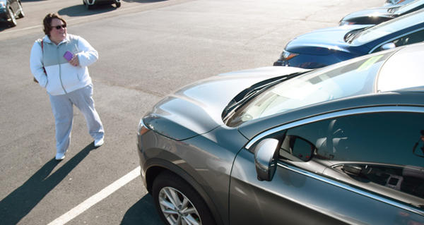 Tifany Brown looks at a new Nissan Rogue on the Hudiburg Nissan lot at 200 E. I-240 Service Rd. in Oklahoma City.