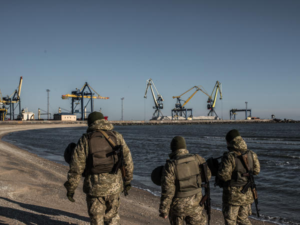Ukraine's Border Security Force soldiers patrol the coast of the Azov Sea near Mariupol Port on Thursday.