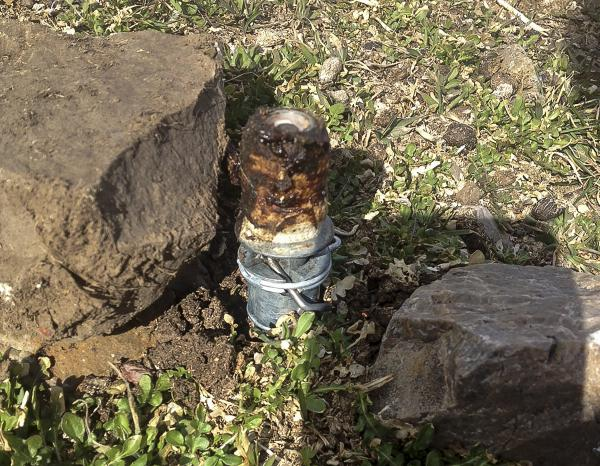 This Thursday, March 16, 2017 photo released by the Bannock County Sheriff's Office shows a cyanide device in Pocatello, Idaho. The cyanide device, called M-44, is spring-activated and shoots poison that is meant to kill predators.