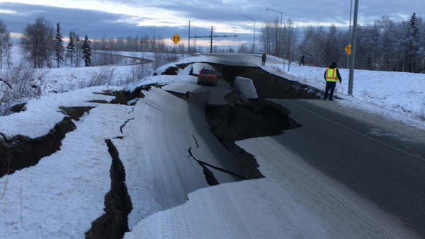 After an earthquake on Friday, a car is trapped in a crumbled section of an off-ramp from Minnesota Drive, a major road in Anchorage, Alaska.