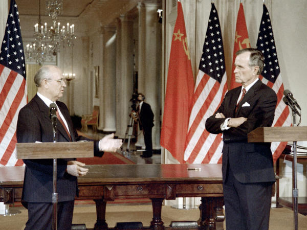 Bush talks with Soviet President Mikhail Gorbachev during a signing ceremony at the White House on June 1, 1990. Bush and Gorbachev signed the foundation of a treaty for the first-ever cuts in nuclear missiles and a pact to slash chemical weapon stockpiles.