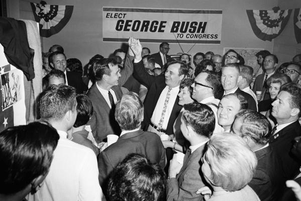 Bush celebrates after winning the U.S. House seat for Texas' 7th District in 1966.