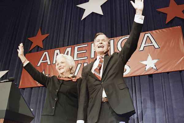 Bush and his wife, Barbara, wave at a victory party after he beat Democrat Michael Dukakis in the 1988 presidential election.