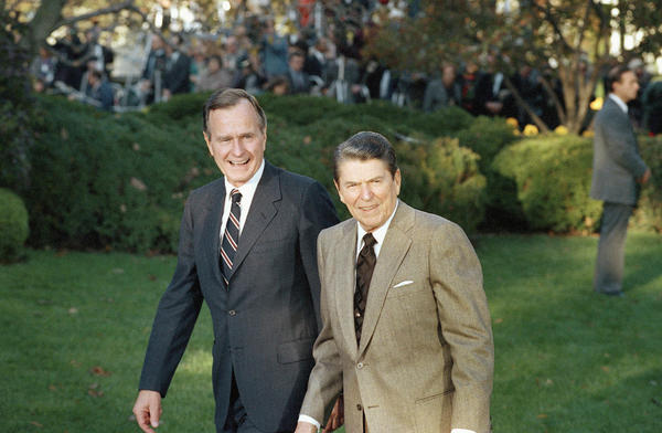 President Ronald Reagan greets President-elect George H.W. Bush at the White House on Nov. 10, 1988.