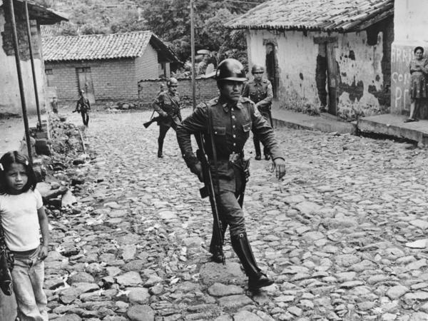 Government forces patrol a village in northern El Salvador on Nov. 1, 1979.
