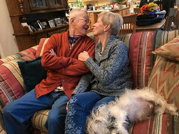 Ed, Kathy and their dog Charlie at home in Aurora, Colo.
