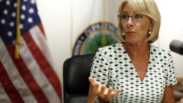Education Secretary Betsy DeVos speaks with the media after a series of listening sessions about campus sexual violence in July 2017. Among the significant changes is that schools can make it harder to prove allegations.