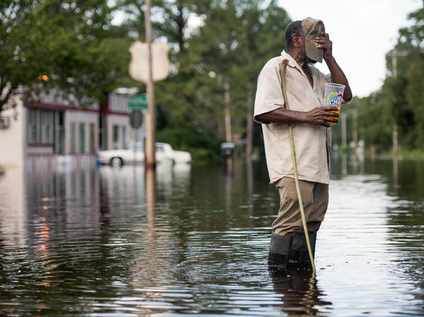 Larry Hickman stands in floodwaters caused by Hurricane Florence in September in Bucksport, S.C.