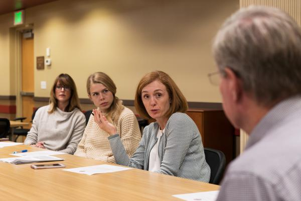 Left to right, at a meeting of the coalition: Jacquelyn Clark, co-owner of the Bristlecone Shooting, Training, & Retail Center in Lakewood, Colo.; Sarah Hershman, a medical student at the University of Colorado; Betz and Dick Abramson, owner of the Centennial Gun Club.