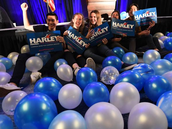 Supporters of Democrat Harley Rouda celebrate as they watch the returns on election night. Rouda was one of four Democrats who unseated Republican House members in Orange County, Calif., signaling a political shift in the once conservative area.