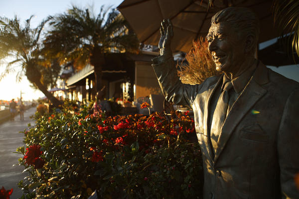 A statue of former President Ronald Reagan stands in front of a home on Orange County's Balboa Island. Reagan's political career and the Republican Party of the 1970s and '80s were long associated with Orange County, but the party was swept out of power there in this year's midterm elections.