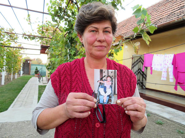 Liliana Czegledi holds a photo of her daughter, Ioana, at her home in the village of Sînandrei in western Romania. Ioana was just shy of her 10th birthday when she died of complications from measles. She could not be vaccinated because she had a compromised immune system.