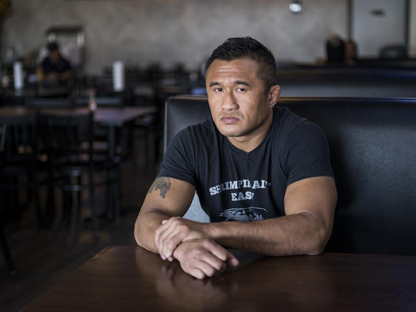 Mike Trinh — kick boxer turned restauranteur — sits inside Mike's Seafood in Houston's Little Saigon