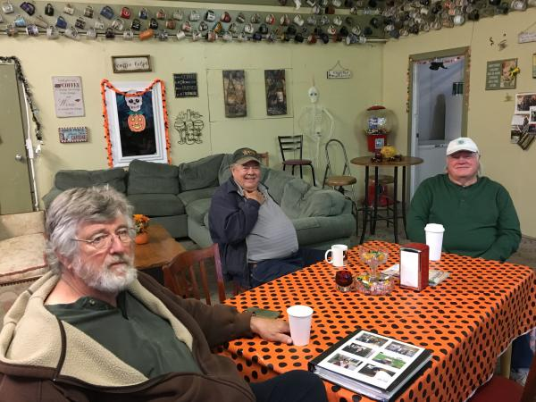 Dennis Hall (from left), Bob Bement and Steve Paulsen get together most mornings at the Lucky Cup in Vale, Ore. They drink coffee, crack jokes and largely steer clear of talk about politics and the media. But they're quick to praise the <em>Malheur Enterprise,</em> the local weekly paper headquartered in Vale.