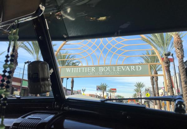 East L.A.'s Whittier Boulevard in 2018, seen from inside a classic Chevy.