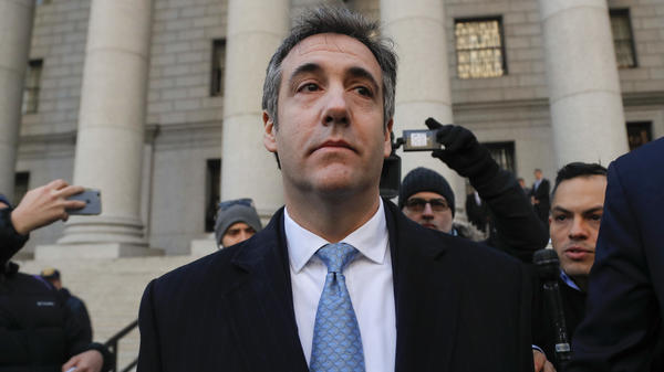 Michael Cohen walks out of federal court Thursday in New York, after pleading guilty to lying to Congress about work he did on an aborted project to build a Trump Tower in Russia.