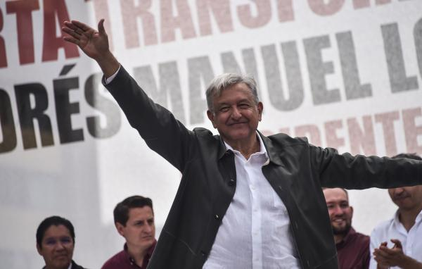 Mexican President-elect Andrés Manuel López Obrador waves to supporters during his national tour to thank those who voted for him in the July 1 elections, at the Plaza de las Tres Culturas in Mexico City, in late September.