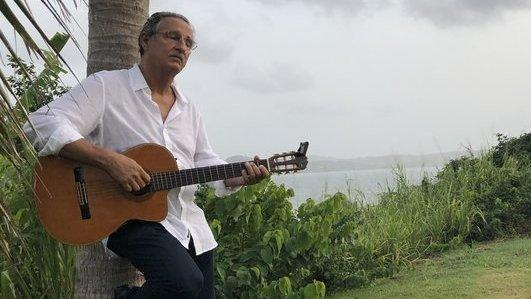 Singer Alberto Carrión performs <em>Amanecer Borincano</em>, his song about sunrise over Puerto Rico, at the point where Hurricane Maria made landfall one year ago.