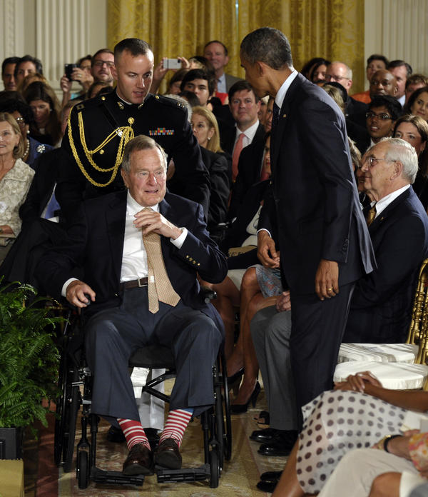Bush wears red and white socks February, 2011 when President Obama awarded him the Medal of Freedom.