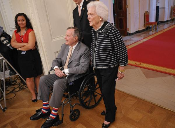 George H.W. Bush and his wife Barbara attend the portrait unveiling of former President George W. Bush and his wife Laura Bush on May 31, 2012, at the White House.