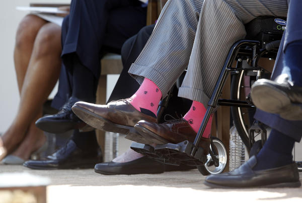 Former President George H.W. Bush wears pink socks as he is seated in a wheelchair at the dedication of the George W. Bush Presidential Library on the campus of Southern Methodist University in Dallas, on April 25, 2013.