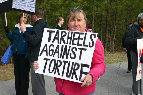 Protester with NC Stop Torture Now