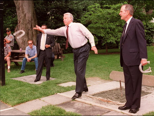 Russian President Boris Yeltsin throws a horseshoe while playing the game outside the White House Oval Office with then-President George Bush in 1992.