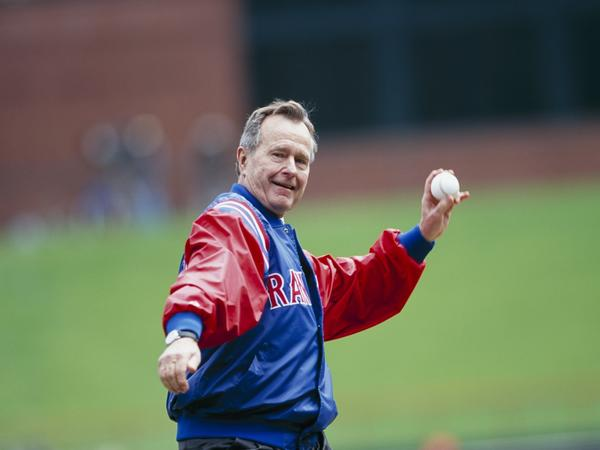George H.W. Bush throws out the first pitch before the Texas Rangers Opening Day game against the Chicago White Sox at The Ballpark in Arlington on April 3, 2000 in Arlington, Texas.