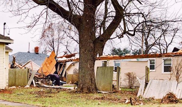 A tornado damaged a residence in Hewittville, Illinois, on Saturday, December 1, 2018.