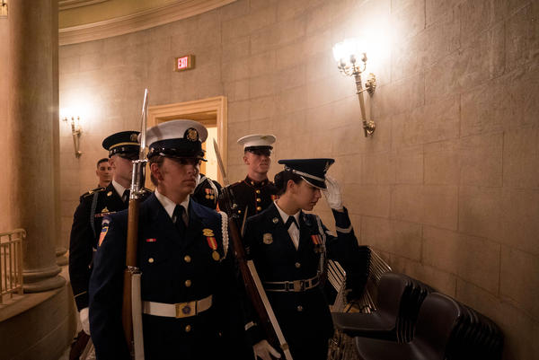 A military honor guard waits to stand watch over the former president's remains.