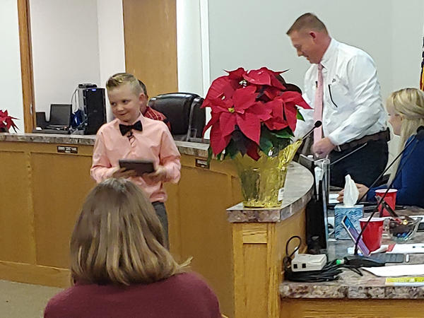 Dane Best, 9, attended a meeting with the town trustees in Severance, Colo., to over turn a long-held ban on snowballs on Monday.