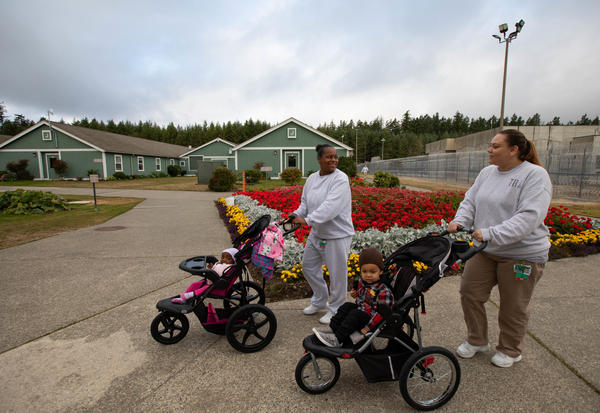 Daidre Kimp and Crystal Lansdale spend time with their children outside the women's residential parenting building at the correctional center in Gig Harbor.