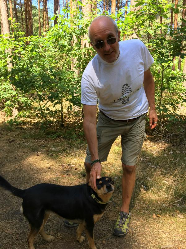 Soil ecologist Hans-Holger Liste out for a walk in the woods by his home near Berlin. He welcomes the returning wolf population in this region, and takes part in pro-wolf activism.