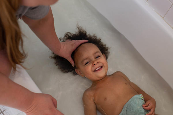 It's bath time for Kirshawn, 2. The bathroom is shared space at the women's residential parenting building.