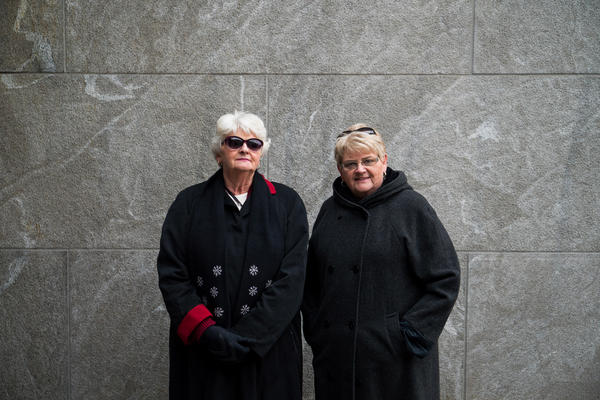 "Suellen Wheatley-Wilkins, right, with her sister Deborah, are longtime admirers of the former President. ""He just set such a standard for the entire country,"" Suellen said. ""He loved his country and he respected the people."""