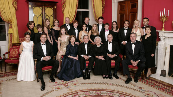 Then-President George W. Bush, then-first lady Laura Bush, former first lady Barbara Bush and former President George H.W. Bush sit surrounded by family in the Red Room of the White House on Jan. 6, 2005, in Washington, D.C. Friends and family joined former President Bush and Barbara Bush in celebrating their 60th wedding anniversary at a dinner.