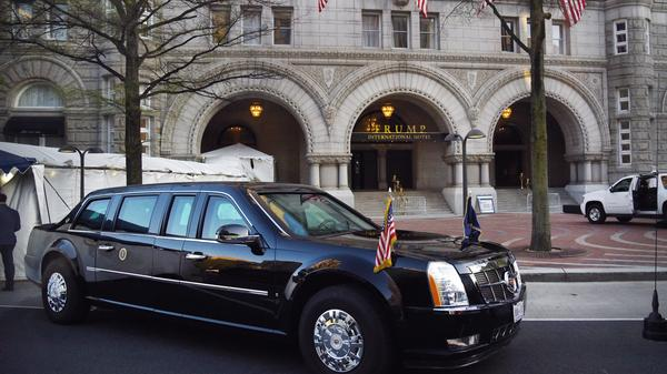 "The presidential limousine, aka ""The Beast,"" is parked in front of the Trump International Hotel as President Trump attends dinner with supporters on April 30 in Washington, D.C."